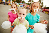 Girls with cotton candy — Stock Photo