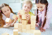 Little friends playing with bricks — Stock Photo