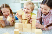 Friends playing with bricks — Stock Photo
