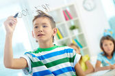 Clever boy doing sums — Stock Photo