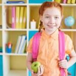 Schoolgirl with apple — Stock Photo #51574001