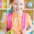 Girl with backpack and apple — Stock Photo #51574003