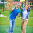 Couple playing with flying disc — Stock Photo #51577447