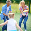Family playing with flying disc — Stock Photo #51577487