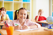 Schoolgirl drawing at lesson — Stock Photo