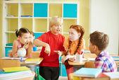 Boy talking to his classmates — Stock fotografie
