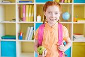 Schoolgirl with apple — Stock Photo