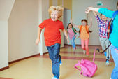 Classmates running down the corridor — Stock Photo