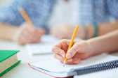 Student carrying out written task — Stock Photo
