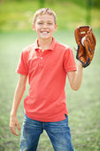 Boy with caught baseball — Stock Photo