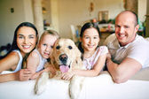 Family of four with pet — Photo