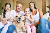 Father, mother, two daughters and dog — Stock Photo