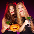 Females holding Halloween pumpkin — Stock Photo #51580231