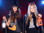 Halloween girls with lanterns — Stock Photo