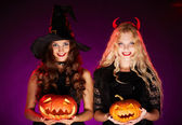 Women with pumpkins — Stock Photo