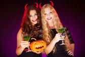 Females holding Halloween pumpkin — Stock Photo