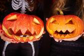 Halloween pumpkins on female palms — Stock Photo