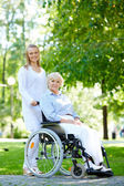 Doctor and patient in park — Stock Photo
