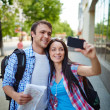 Woman taking photo of herself and boyfriend — Stock Photo #51631699