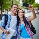 Woman taking photo of herself and boyfriend — Stock Photo