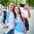 Woman taking photo of herself and boyfriend — Stock Photo #51631707