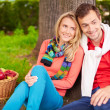 Young couple sitting in park — Stock Photo #51631935