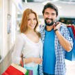 Couple with paperbags in mall — Stock Photo #51633497