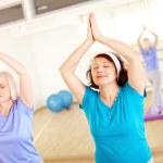 Aged females doing yoga exercise — Stock Photo #51635047