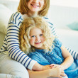 Mother and daughter at home — Stock Photo #51639213