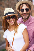 Girl and her boyfriend in hats — Stockfoto