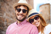 Girl and her boyfriend in hats — Stock Photo
