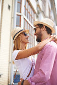 Girl and boyfriend in hats and sunglasses — Stock Photo