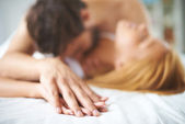 Female and male lying on bed — Foto Stock