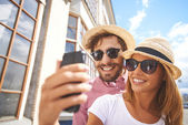 Girl making selfie with  boyfriend — Stock Photo