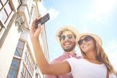 Girl making selfie with boyfriend — Stock Photo