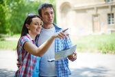 Woman explaining husband sights of city — Stock Photo