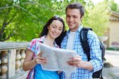 Travelers studying map — Stock Photo
