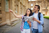 Travelers with map — Stock Photo