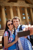 Travelers taking photo of themselves — Stock Photo