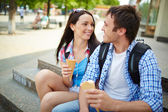 Travelers with ice-cream — Stock Photo