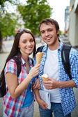 Travelers with ice-cream — Stock Photo