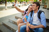 Travelers with ice-cream taking photo of themselves — Stock Photo