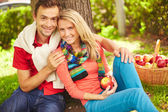 Young couple resting in park — Stock Photo