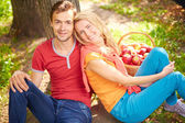 Couple sitting in park — Stock Photo