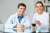 Scientists  with chemical liquids — Stock Photo