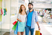 Young couple in the mall — Stock Photo