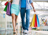 Couple going in the mall — Stock Photo