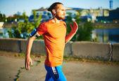 Sportsman running outside — Stock Photo