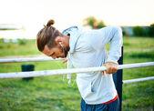 Man training on sport equipment — Stock Photo