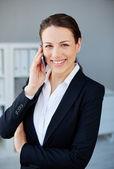 Employee speaking on cellphone — Stock Photo
